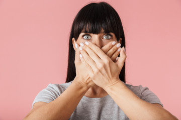 Amazing scared shocked woman posing isolated over light pink background wall.