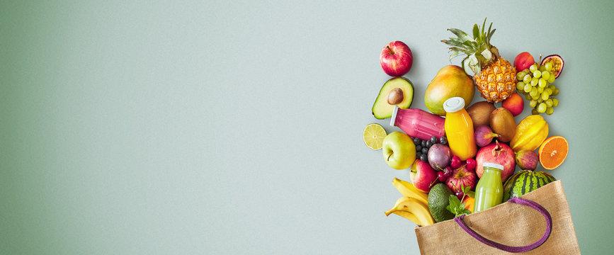 Reusable grocery bag of fresh summer fruit