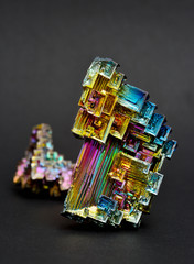 Bismuth crystals on a dark background. This is the most strongly diamagnetic element and also the heaviest that is not radioactive.