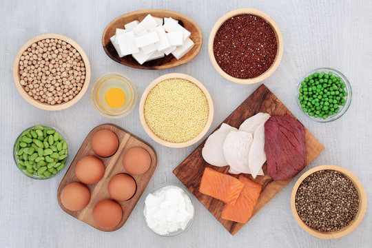 Health food  high in protein with meat, fish, dairy, legumes, bean curd, vegetables, grains, seeds and nuts. Super foods high in dietary fibre, vitamins and antioxidants. Top view.