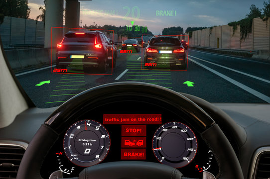 view from the cockpit of a car equipped with HUD and active safety systems.The systems detected a traffic jam on the motorway and activated emergency braking