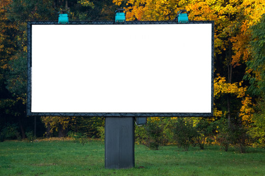 Blank billboard with copyspace surrounded by forest outdoors in