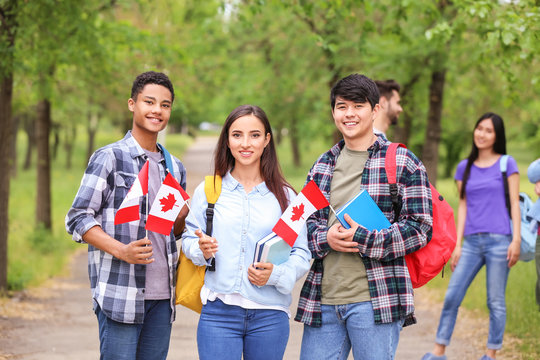 Group of students with Canadian flags outdoors