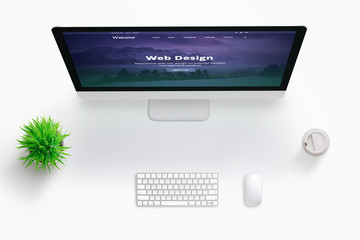 Wall Mural - Web design studio desk with monitor and web site presentation. Copy space in the middle for text. Flat lay.