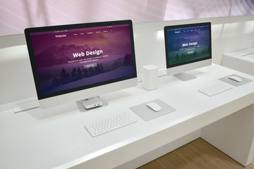 Wall Mural - Web design development studio with two monitors and web site presentations.