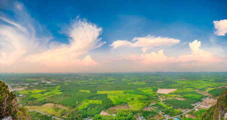 Panorama view of southeast asia countryside landscape with green fields and villages at sunset