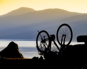 Bike repair against nature fjord in Norway