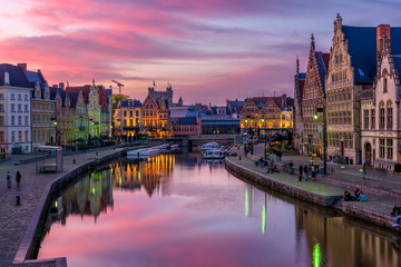View of Graslei, Korenlei quays and Leie river in the historic city center in Ghent (Gent), Belgium. Architecture and landmark of Ghent. Sunset cityscape of Ghent. Wall mural