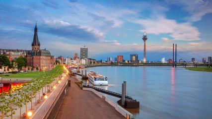 Fototapete - Dusseldorf, Germany. Panoramic cityscape image of riverside Düsseldorf, Germany with Rhine river during sunset.