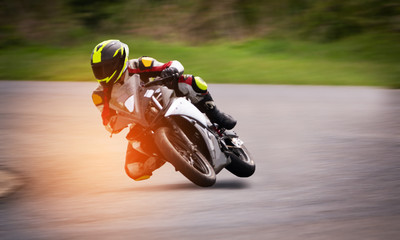 Motorcycle racing on asphalt track.