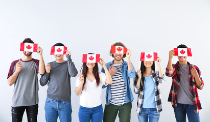 Group of students with Canadian flags on light background Fototapete