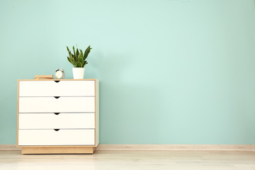 Chest of drawers near color wall
