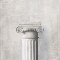 Stone column on light gray background. Close-up, copy space, front view, toned, square format