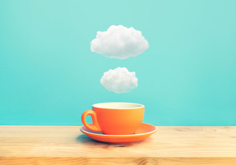 Inspiration creativity concepts with a cup of coffee on wood bar table with some cloud on blue sky color background Fotoväggar