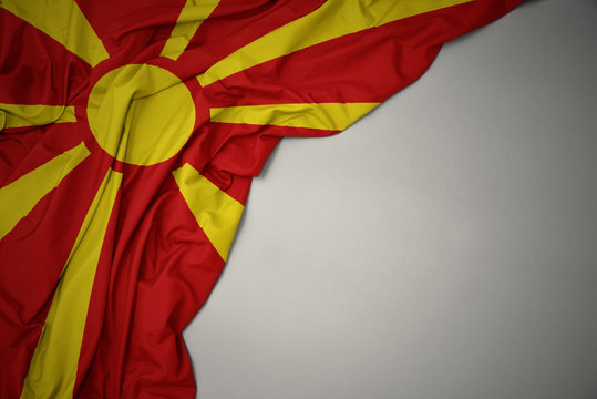 waving national flag of macedonia on a gray background.