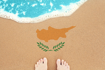 Garden Poster Cyprus Feet on the sunny sandy beach with flag Cyprus. View from top on surf.