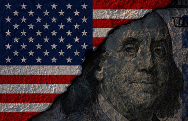 Closeup of Benjamin Franklin former US president on US dollar banknote and USA flag. USD is the main currency exchange in the world.