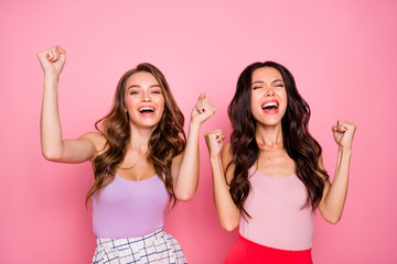 Portrait of charming nice pretty youth delighted positive cheerful content candid rejoice scream shout yeah raise hands fists reaction wear modern youngster clothing isolated pink background Fototapete