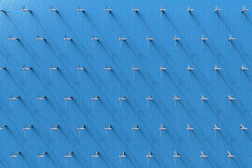 3D rendering of an aerial view of wind turbines in the ocean