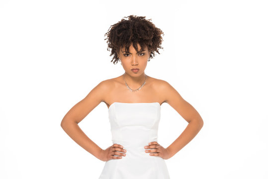 angry african american bride standing with hands on hips isolated on white