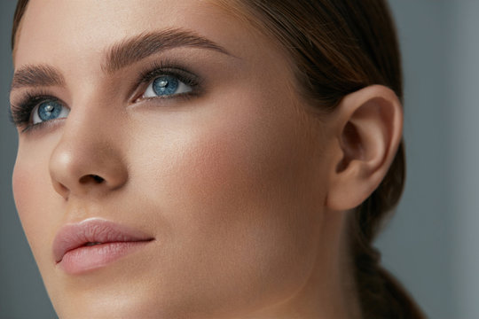 Beauty makeup. Woman face with eyes and eyebrows make-up
