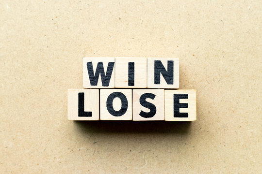 Letter block in word win lose on wood background (Concept of game theory)