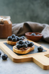 Toasts with chocolate spread and blueberries. Delicious breakfast or snack