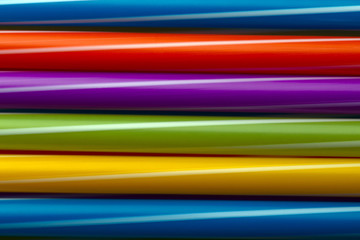 Wall Mural - colored cocktail tubes, abstract background, concept accessories to celebrate your party