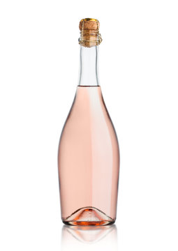 Glass bottle of homemade pink rose champagne with cork on white background.