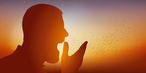 Concept de la contagion d'une épidémie de grippe, avec un malade contaminé, qui éternue et propage ses microbes, en éternuant, bien que mettant sa main devant la bouche.