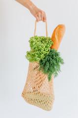 woman shopping eko style string bag vegetables