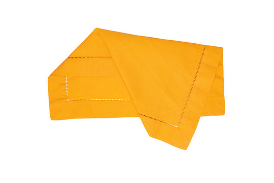 Closeup of a yellow napkin or tablecloth isolated on white background. Kitchen accessories.