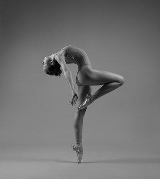 Flexible ballerina in pointe bends back