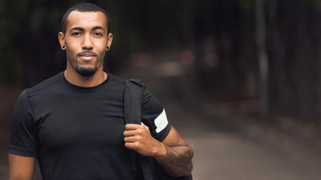 Sporty Man Posing After Workout, Wearing Black T-Shirt