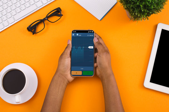 Investor analyzing stock market investments on smartphone