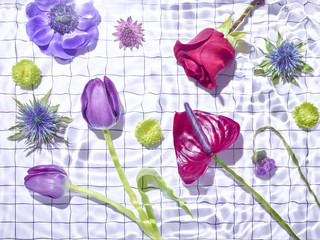 Variety of flowers on white satin fabric grid