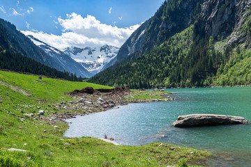 Wall Mural - Mountain lake landscape in the Alps, Austria, Tyrol, Stilluptal Lake, Zillertal Alps Nature Park