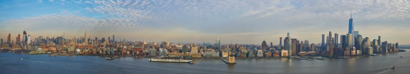 Ultra wide panorama of Manhattan skyline showing downtown financial district and midtown up to central park