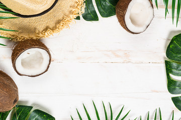 Palm leaves and coconut on whitee top view. Wall mural