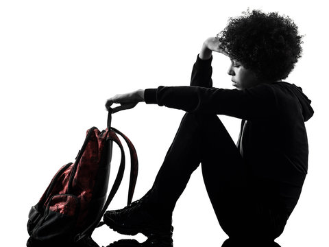one mixed race african young teenager girl woman sadness depression in studio shadow silhouette isolated on white background