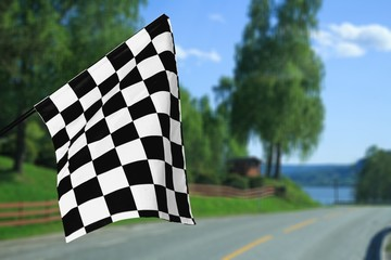 Checkered waving flag on city background. Concept