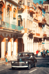 Poster Havana Colorful buildings and a classic car in Old Havana