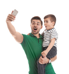 Portrait of dad taking selfie with his son isolated on white