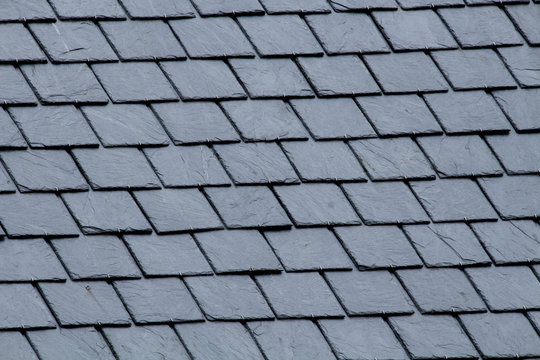 New slate roof, slate texture, perfect shape. Slating roof. Grey colors.