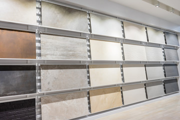 Colorful samples of a ceramic tile in shop. Marble and granite flooring a most popular choice for modern kitchens and bathrooms.