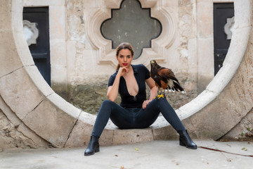 A Lovely Hispanic Brunette Model Poses Outdoors With A Falcon At A Hacienda