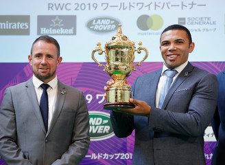 South Africa's Bryan Habana and Wales' Shane Williams poses for a photograph with the Webb Ellis Cup trophy during an event to mark the final 100 days to go for the Rugby World Cup 2019 kick off in Japan, in Tokyo
