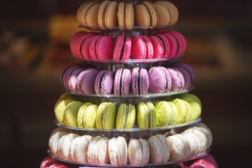 Close up macarons pyramid on shopfront.