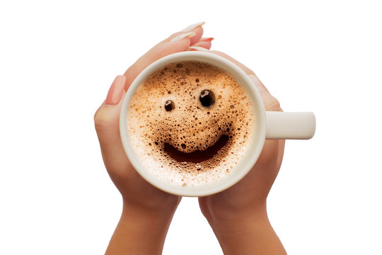 Women's hand holding a cup of coffee smile face frome