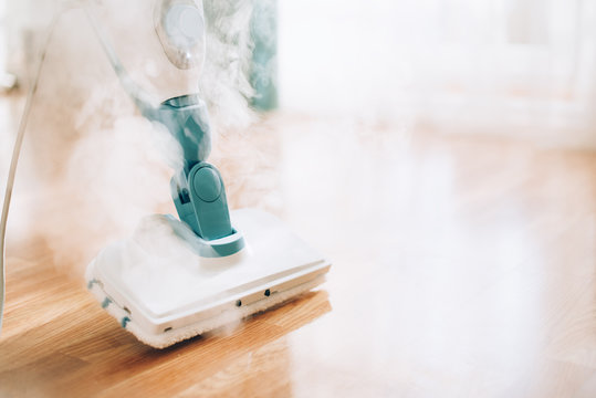Steam cleaner mop cleaining floor. Banner with copy space. Cleaning service concept